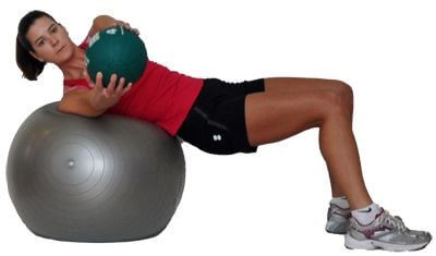 Spine Workout women 4 - Medicine Ball Rotations